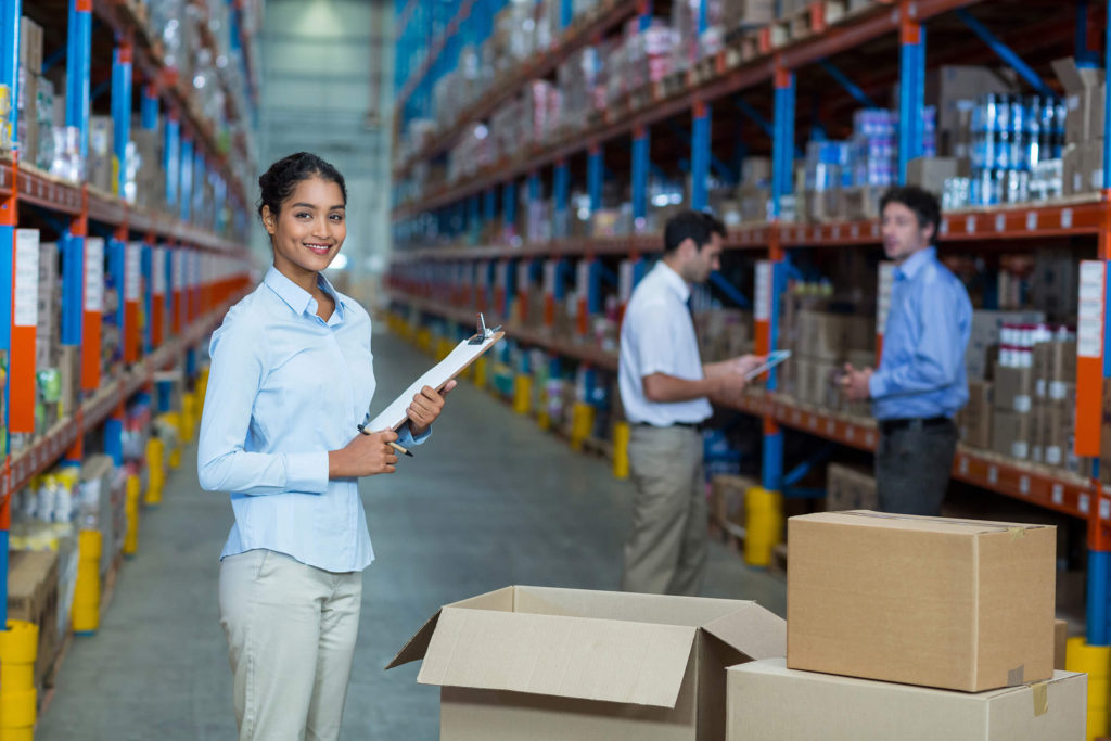 On-site Workforce Management - A woman with a clipboard overseeing two other employees in a warehouse