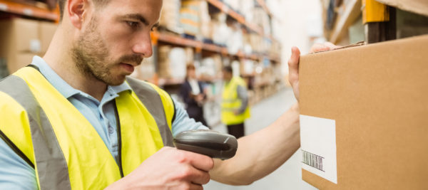 Finding and Hiring Good Seasonal Workers: The Unsung Heroes of the Holidays - Warehouse working scans barcode on a box - temporary staffing in rochester, ny