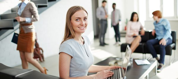 woman sitting in office with coworkers
